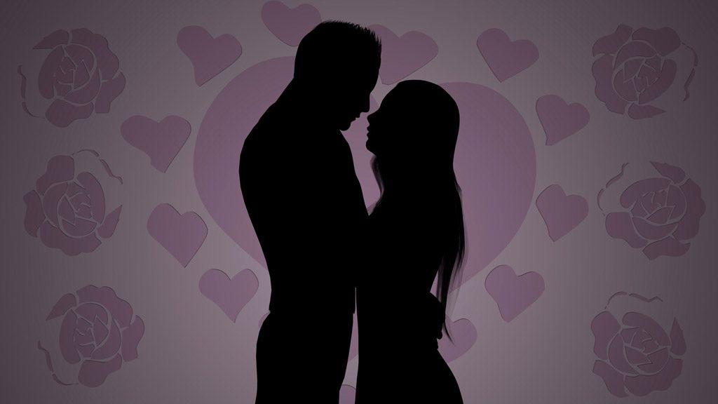 抱き合うカップルのシルエット